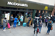 A queue of south Londoners, both diners and Deliveroo riders, outside the McDonalds in Camberwell, on 9th July 2021, in London, England.