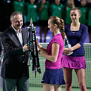 Petra Kvitova (2ndR) of Czech Republic holds up the trophy after she won the final match against Victoria Azarenka (R) of Belarus at the WTA Championships tennis tournament in Istanbul, Turkey on 30 October 2011. Photo by TURKPIX