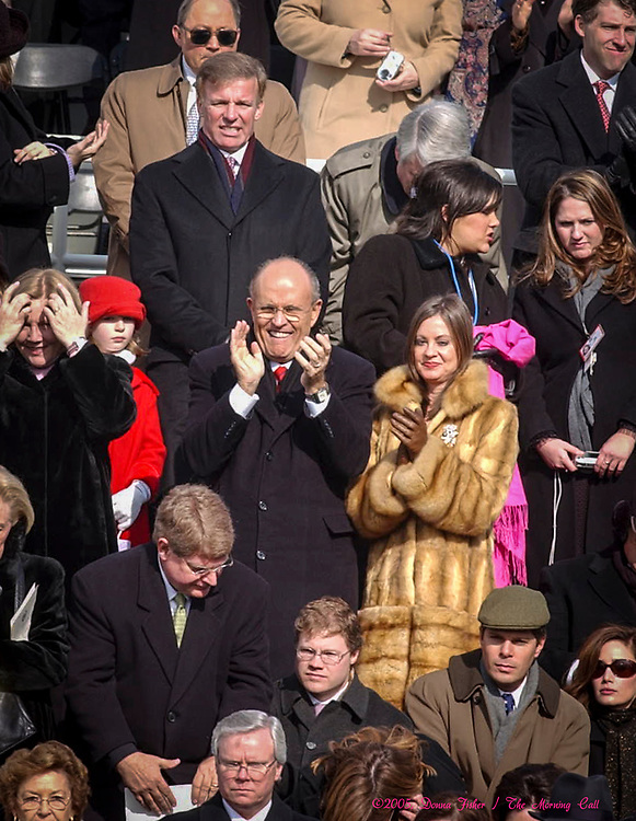 WASHINGTON, D.C. - Rudy and Judith Giuliani, center, at George W. Bush Inauguration.  Inauguration ceremonies for the second term of President George W. Bush at the U.S. Capitol, along the National Mall and along Pennsylvania Avenue on January 19, 2005 and January 20, 2005. Photography ©DONNA FISHER/The Morning Call