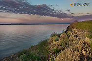Full moon sets over Fort Peck Reservoir in the CM Russell National Wildlife Refuge near fort Peck, Montana, USA