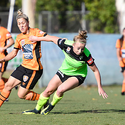 BRISBANE, AUSTRALIA - OCTOBER 30: Katrina Gorry of the Roar and Hannah Brewer of Canberra United compete for the ball during the round 3 Westfield W-League match between the Brisbane Roar and Canberra United at AJ Kelly Field on November 20, 2016 in Brisbane, Australia. (Photo by Patrick Kearney/Brisbane Roar)