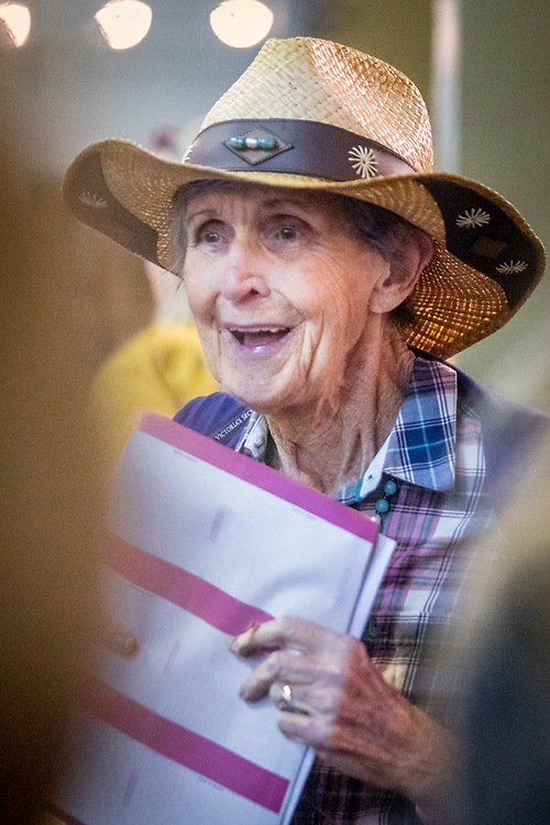 Ellie Leake clutches her Bingo cards as she searches for a seat at the Community Bingo event sponsored by local Fire Fighter's were money was raised for victims of recent wild fires in Sonoma and Napa Counties.