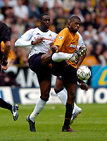 Photo. Jed Wee, Digitalsport<br /> NORWAY ONLY<br /> <br /> Wolverhampton Wanderers v Tottenham Hotspurs, FA Barclaycard Premiership, 15/05/2004.<br /> Spurs' Ledley King (L) sticks close to Wolves' Carl Cort
