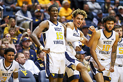 Nov 28, 2018; Morgantown, WV, USA; West Virginia Mountaineers forward Lamont West (15) and West Virginia Mountaineers forward Emmitt Matthews Jr. (11) celebrate from the bench during the second half against the Rider Broncs at WVU Coliseum. Mandatory Credit: Ben Queen-USA TODAY Sports