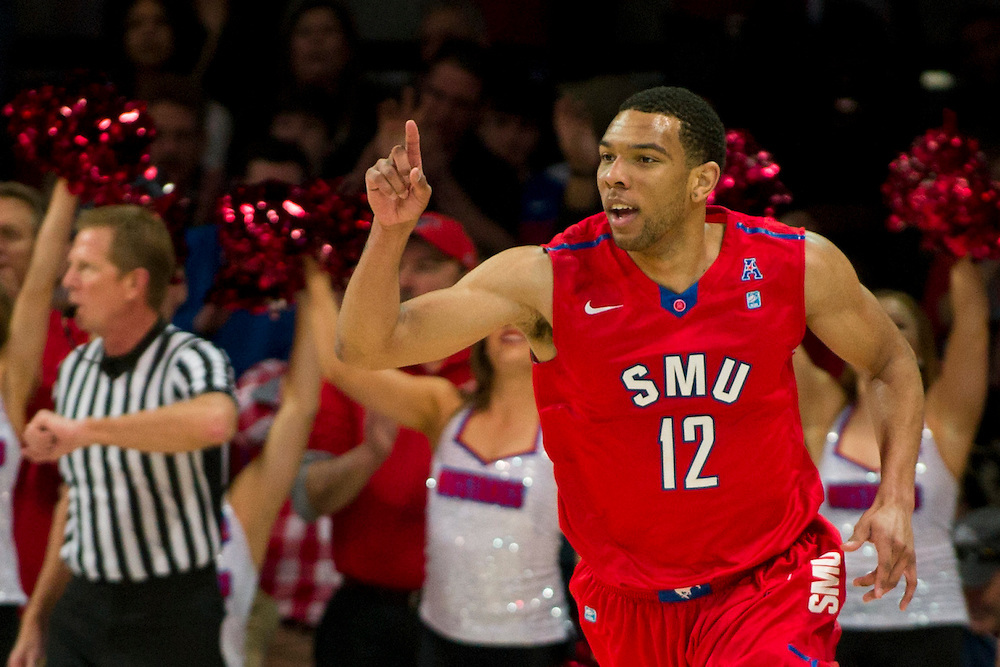 DALLAS, TX - JANUARY 4: Nick Russell #12 of the SMU Mustangs reacts after a made basket against the Connecticut Huskies on January 4, 2014 at Moody Coliseum in Dallas, Texas.  (Photo by Cooper Neill) *** Local Caption *** Nick Russell