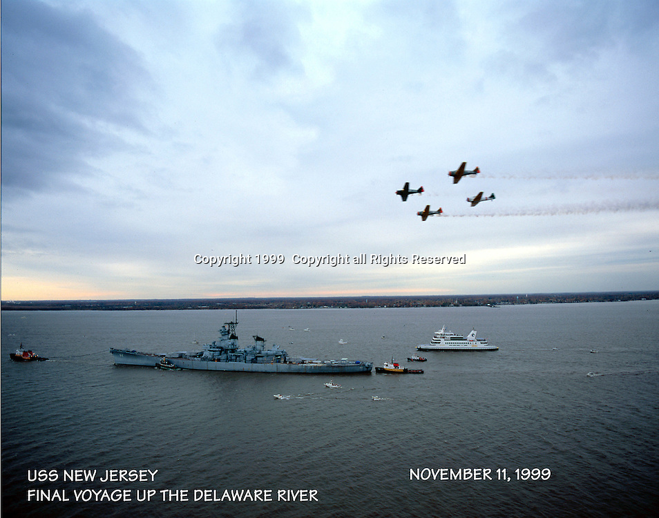 Aerial view of the Battleship New Jersey and WWII flyover along the Delaware River during its final voyage up the Delaware in 1999.