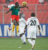 Photo: Steve Bond/Richard Lane Photography.<br />Cameroun v Zambia. Africa Cup of Nations. 26/01/2008. Joseph Desire Job (upper L) wins the ball in the air