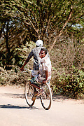 A local man on the back of a bicycle towards Amboasary Sud, near the Berenty Reserve, Madagascar