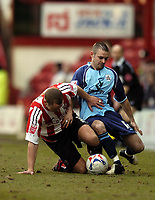 Photo: Olly Greenwood.<br />Brentford v Barnsley. Coca Cola League 1. 11/03/2006. Brentford's Andy Frampton and Barnsley's Neil Austin