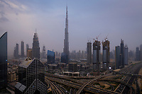 UNITED ARAB EMIRATES, DUBAI - CIRCA JANUARY 2017: Sheikh Zayed Road and Burj Khalifa in the afternoon. This is the main artery of the city and is home for most of the Dubai skyscrapers.
