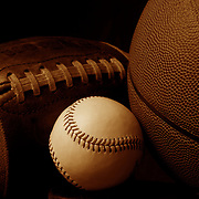 A studio shot of an American Football, a baseball, and a basketball. 17th October 2012. Photo Tim Clayton