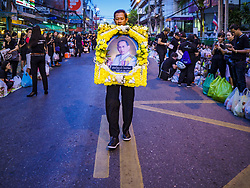October 13, 2017 - Bangkok, Bangkok, Thailand - A man carries a portrait of Bhumibol Adulyadej, the King of Thailand, into a mass merit making with 199 Buddhist monks from 14 different temples at Siriraj Hospital in Bangkok. The revered king died on October 13, 2016 after a prolonged hospitalization. He has lain in state for the last year. The King's four day funeral ceremony will be October 25 - 29, and he will be cremated on October 26. (Credit Image: © Sean Edison via ZUMA Wire)