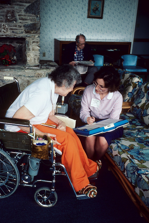 Anglo Democratic woman vists elderly disabled Anglo woman at her home in low-income neighborhood in Austin, Texas.<br /> ©Bob Daemmrich