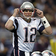 New England Patriots quarterback Tom Brady calls out some singlals during the second quarter against St. Louis at the Edward Jones Dome in St. Louis, Missouri, November 7, 2004.