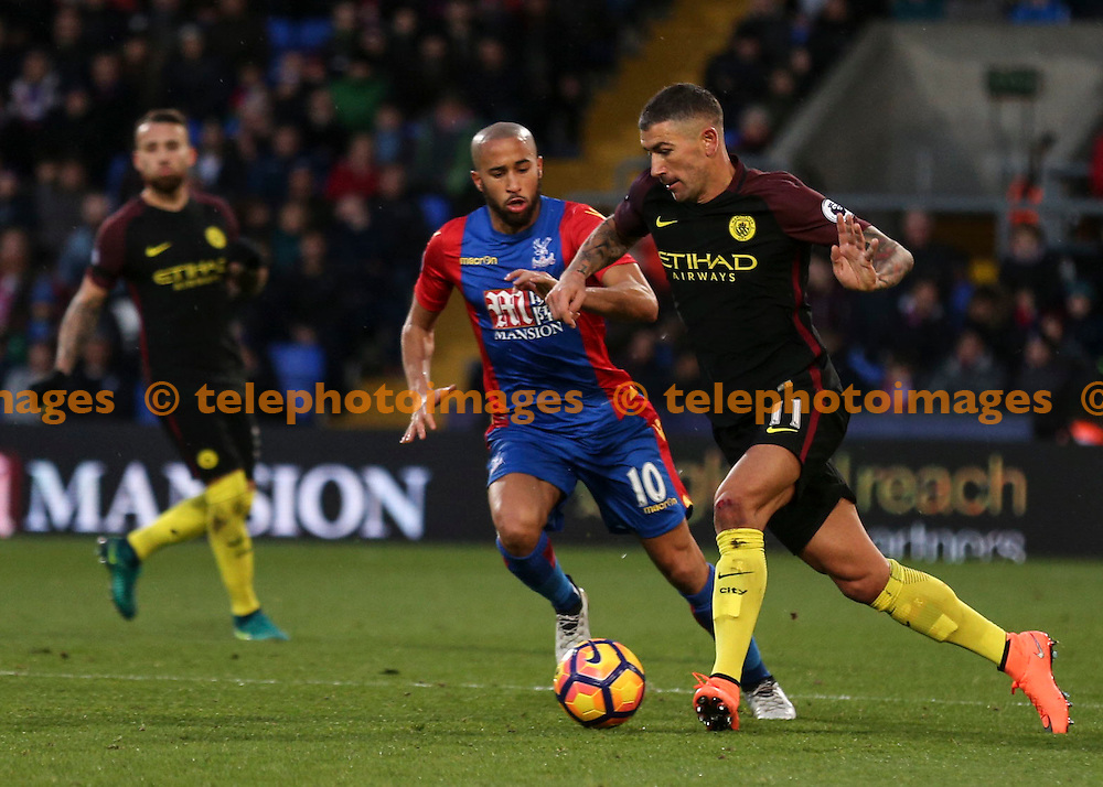 Aleksandar Kolarov holds the ball from Andros Townsend during the Premier League match between Crystal Palace and Manchester City at Selhurst Park in London. Novemeber 19, 2016.<br /> Jack Beard / Telephoto Images<br /> +44 7967 642437
