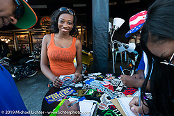 Shantrel Mosley works the HD display at the Biking on the Boulevard event during Daytona Bike Week. FL, USA. March 14, 2014.  Photography ©2014 Michael Lichter.