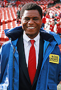 Sports analyst Irv Cross smiles as he watches pregame warmups before the San Francisco 49ers NFL NFC Championship playoff football game against the Los Angeles Rams on Jan. 14, 1990 in San Francisco. The 49ers won the game 30-3. (©Paul Anthony Spinelli)