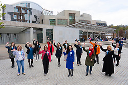 Edinburgh, Scottish Borders, Scotland, UK. 2  May 2021. ALBA party women candidates  gathered outside the Scottish Parliament to highlight the ALBA Women and Equalities policy. Under the hashtag Women Voting With Our Feet, hundreds of pairs of women's shoes were laid out in front of Scottish Parliament with messages of support for sex-based rights of women. ALBA list candidate  Tasmina Ahmed-Sheikh said that ALBA are making it loud and clear that they will always stand up for women's sex based rights and that women and girls will always be respected by ALBA. Pic; Female ALBA candidates. Iain Masterton/Alamy Live News