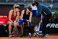 Angelique Kerber of Germany attends to Simona Halep after Halep is forced to retire with injury from the second round of the 2021 Internazionali BNL d'Italia, WTA 1000 tennis tournament on May 12, 2021 at Foro Italico in Rome, Italy - Photo Rob Prange / Spain ProSportsImages / DPPI / ProSportsImages / DPPI