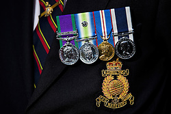 © Licensed to London News Pictures. 07/02/2017. London, UK. Medals worn on the chest of a former Royal Marine  outside the Royal Courts of Justice in London, to show support for Sgt Blackman, who is due to start an appeal against his life sentence for the murder of a wounded Taliban fighter in Afghanistan in 2011.  Photo credit: Ben Cawthra/LNP