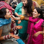 New Delhi, India, January 21, 2011. Marriage of Sumedha and Sapan. Sumedha during the propitiatory celebrations for the Bride. Sumedha's face is massaged by family members with a paste of turmeric, a spice known for its purifying qualities. Turmeric is also used in Ayurvedic medicine.