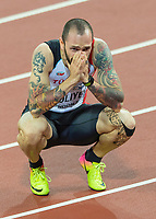 Athletics - 2017 IAAF London World Athletics Championships - Day Seven, Evening Session<br /> <br /> Mens 200m Final<br /> <br /> Ramil Guliyez (Turkey) take a moment to pause and think after  he crosses the line to become World Champion at the London Stadium<br /> <br /> COLORSPORT/DANIEL BEARHAM