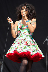 © licensed to London News Pictures . 30/06/2012 . Manchester , UK . Hollie Cook performs on stage at Heaton Park as warm up for the Stone Roses , who are on their comeback tour . Photo credit : Joel Goodman/LNP