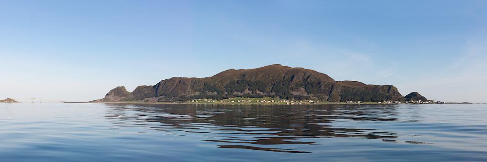 The island Runde, Nearby Fosnavåg, is located on the vestern part of Norway, and is famous for it's rich birdlife, and stunning nature   Panoramabilde av fugleøya Runde en tidlig morgen, mef flatt hav og refleksjon i sjøen.