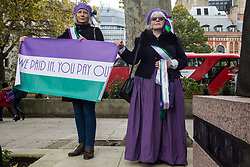 London, UK. 5 November, 2019. Campaigners from WASPI (Women Against State Pension Inequality) dressed as suffragettes protest in Parliament Square to call for fair transitional pension arrangements for women born in the 1950s affected by the changes to the State Pension Age (SPA), including a 'bridging' pension to provide an income from age 60 until State Pension Age and recompense for losses incurred by women who have already reached their SPA.