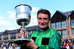 Daryl Jacob with the trophy after winning the ES Champion Four Year Old Hurdle onboard Fusil Raffles during day five of the Punchestown Festival at Punchestown Racecourse, County Kildare, Ireland.