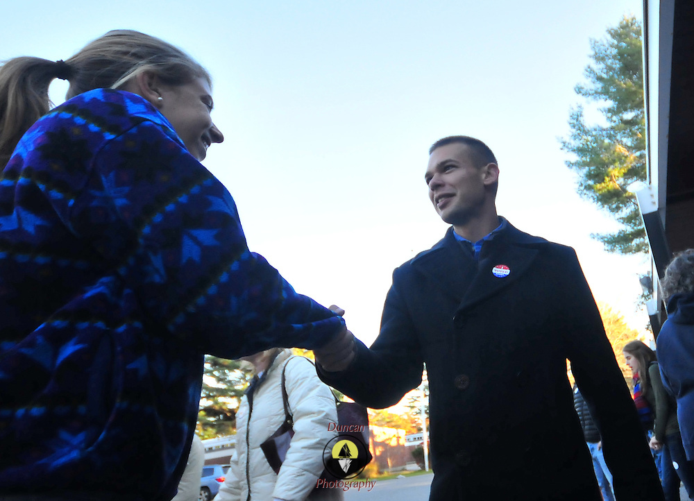 11/2/10 -- BRUNSWICK, Maine. Incumbent Democrat, Alex Cornell du Houx  greets a voter coming to the at the polls on Tuesday afternoon..Turnout across the region at the polls was high -- according to several different candidates. They each said that due to close races at many different levels, it appeared that voters came out more than they might otherwise have. Traffic flowed through the polls steadily throughout the day. Photo by Roger S. Duncan.