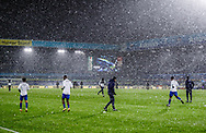 Players warm down after the match in the snow during the Premier League match between Leeds United and Crystal Palace at Elland Road, Leeds, England on 8 February 2021.