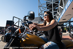 Cynthia Lado of the Philippines checks out a brand new 2015 Harley at the Harley-Davidson Museum where the multi-acre campus acted as the central rally point during the Harley-Davidson 115th Anniversary Celebration event. Milwaukee, WI. USA. Thursday August 30, 2018. Photography ©2018 Michael Lichter.