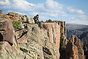 Obadiah Reid takes pictures from near Big Island View, Black Canyon of the Gunnison National Park, Colorado.