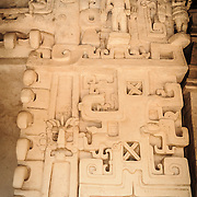"""Some of the intricate carvings decorating exterior of the Tomb of Ukit Kan Le'k Tok' on top of the Acropolis on the northern side of the Ek'Balam archeological site on Mexico's Yucatan Peninsula. It was once a thriving city of Maya Civilization dating to the Late Classic period. It is 30km north of Valladolid and is named for """"Black Jaguar"""" a distinctive motif throughout the site."""