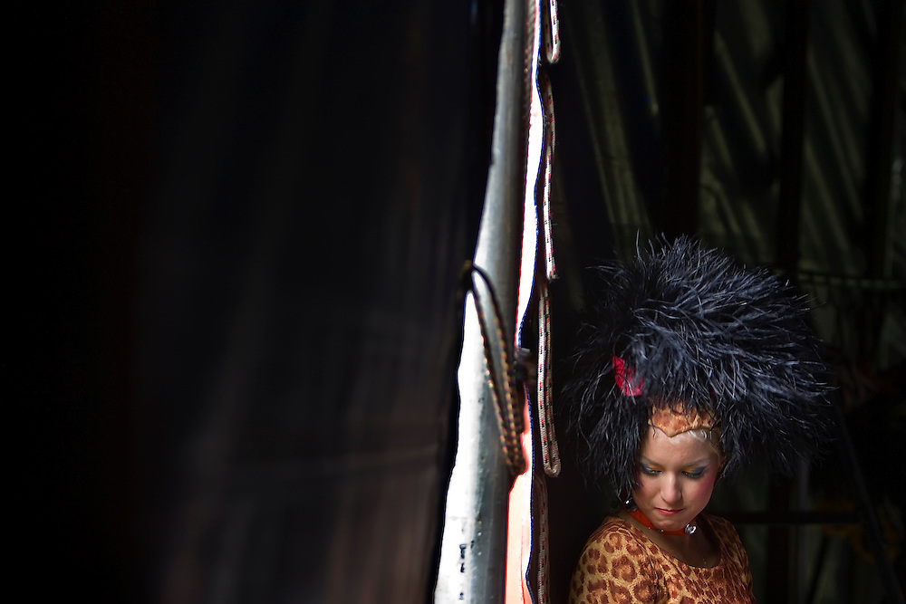Ana dos Santos, a performer and acrobat with the Carson & Barnes Circus, waited inside the big top for her cue to enter at the Johnson County Fairgrounds in Gardner, Kan.