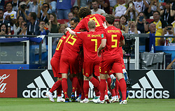 Belgium players celebrate the first goal of the game after Brazil's Fernandinho (not pictured) scored an own-goal