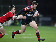 Hallam Amos of the Newport Gwent Dragons is held back by Darren Sweetnam  of Munster (l). <br /> Guinness Pro12 rugby match, Munster v Newport Gwent Dragons at Thomond Park in Limerick , Ireland on Saturday 5th March 2016.<br /> pic by  John Halas, Andrew Orchard sports photography.