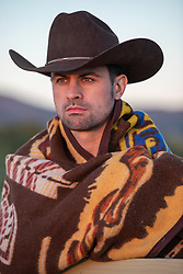 hot cowboy with a blanket at sunset