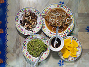 Greens, squid, fish and mangoe. Diner at Selakan island.
