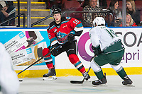 KELOWNA, BC - SEPTEMBER 28:   Michael Farren #16 of the Kelowna Rockets looks for the pass as Bryce Kindopp #19 of the Everett Silvertips skates in for the check at Prospera Place on September 28, 2019 in Kelowna, Canada. (Photo by Marissa Baecker/Shoot the Breeze)