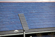 A roof tiled with photovoltaic solar energy panels receives maximum sunlight exposure. A Freestanding panel powers a street light. These panels are made up of photovoltaic (PV) cells. PV cells convert sunlight into electrical energy. Photovoltaic panels are an economical, efficient way to produce electricity.