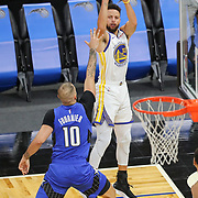 ORLANDO, FL - FEBRUARY 19:  Stephen Curry #30 of the Golden State Warriors shoots over the head of Evan Fournier #10 of the Orlando Magic during the first half at Amway Center on February 19, 2021 in Orlando, Florida. NOTE TO USER: User expressly acknowledges and agrees that, by downloading and or using this photograph, User is consenting to the terms and conditions of the Getty Images License Agreement. (Photo by Alex Menendez/Getty Images)*** Local Caption *** Stephen Curry; Evan Fournier