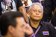 26 NOVEMBER 2013 - BANGKOK, THAILAND: Former Deputy Prime Minister SUTHEP THAUGSUBAN, leader of the anti-government protests rocking Bangkok, at a press conference in the Ministry of Finance building. The Thai government issued as warrant for Suthep as the protests spread but he has not been arrested. Protestors opposed to the government of Thai Prime Minister Yingluck Shinawatra spread out through Bangkok this week. Protestors have taken over the Ministry of Finance, Ministry of Sports and Tourism, Ministry of the Interior and other smaller ministries. The protestors are demanding the Prime Minister resign, the Prime Minister said she will not step down. This is the worst political turmoil in Thailand since 2010 when 90 civilians were killed in an army crackdown against Red Shirt protestors. The Pheu Thai party, supported by the Red Shirts, won the 2011 election and now govern. The protestors demanding the Prime Minister step down are related to the Yellow Shirt protestors that closed airports in Thailand in 2008.     PHOTO BY JACK KURTZ