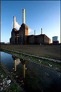 Battersea Power Station, London, UK, showing the exterior of the building and four of the iconic chimneys.