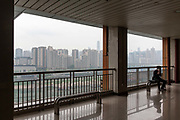 A man chats on his phone while waiting for a CRT Chongqing Rapid Transit monorail at a station in Chongqing, China, on Thursday, April 14, 2016. The municipality of 30 million people saw state-led development approach fueled the fastest pace nationwide, with President Xi Jinping praising policy innovations that have included subsidized housing and relaxed residency rules that encourage labor mobility.