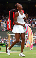 Venus Williams (USA) winces in pain as she walks off after he Semi-Final victory over Kim Clijsters (Belgium)  Wimbledon Tennis Championship, Day 10, 3/07/2003. Credit: Colorsport / Matthew Impey DIGITAL FILE ONLY