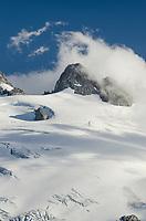 Clouds swirling around summit ridge of Mount Challenger, elevation: 8236 ft / 2510 m North Cascades National Park