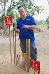 Aki Ra Explaining Markers for Landmines