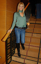 CAROLINE HABIB at a party hosted by Burberry to launch their special collection in aid of Breakthrough Breast Cancer, held at 21-23 New Bond Street, London W1 on 5th October 2004.<br /><br />NON EXCLUSIVE - WORLD RIGHTS